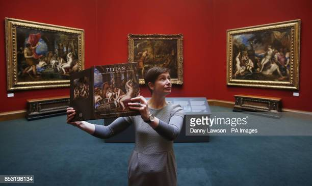 Scottish National Gallery employee Patricia Convery stands in front of three paintings by Titian Diana and Actaeon The Death of Actaeon and Diana and...