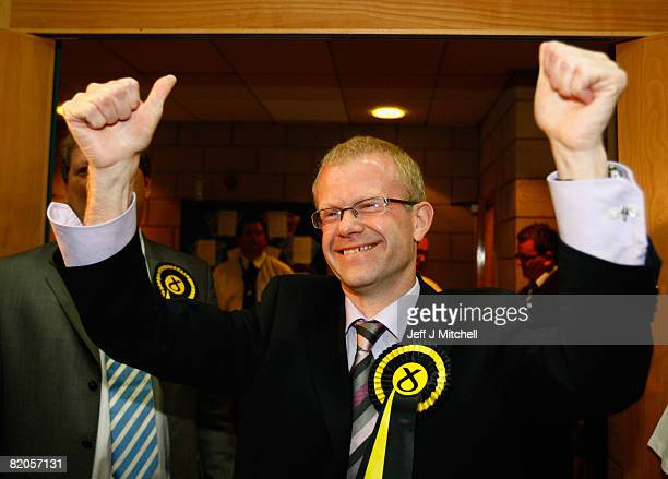 Scottish National Party candidate John Mason arrives at the east end byelection count July 25 2008 in Scotland Nine candidates are vying for the...