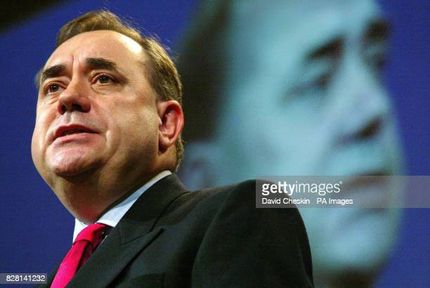 Scottish National Party leader Alex Salmond delivers his speech beneath a huge screen image of himself at the party's annual conference in Aviemore...