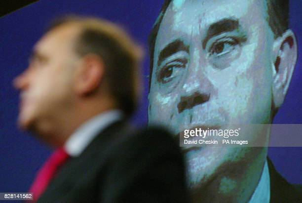 Scottish National Party leader Alex Salmond delivers his speech on stage underneath a huge screen at the party's annual conference in Aviemore Friday...