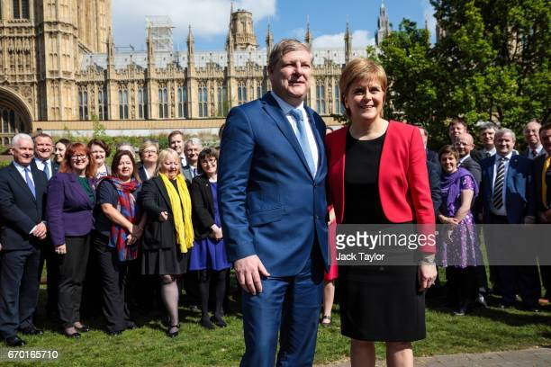 Scottish National Party Leader Nicola Sturgeon and Deputy Leader Angus Robertson are joined by the Party's Westminster group during a photocall in...