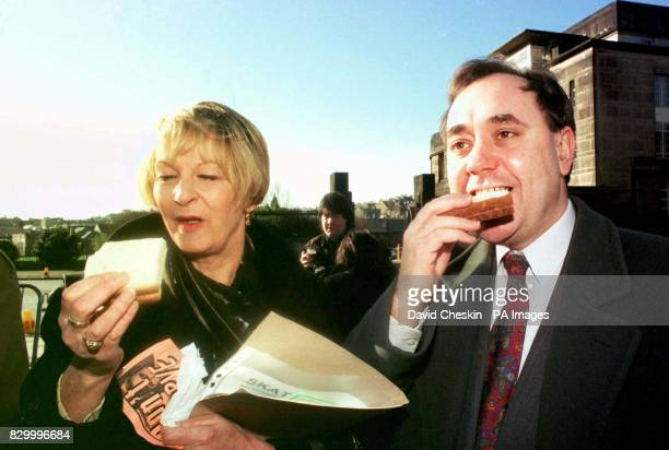 Scottish National Party MP's Alex Salmond and Margeret Ewing outside the New Parliament house in Edinburgh today for the first meeting of the...