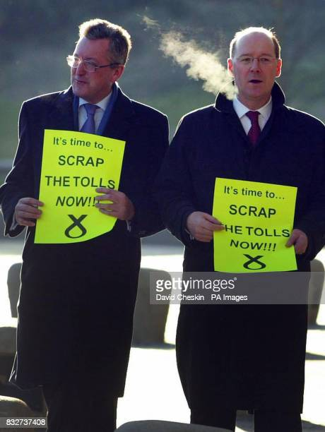 Scottish National Party MSPs Fergus Ewing and John Swinney protest outside the Scottish Parliament in Edinburgh to show their commitment to...