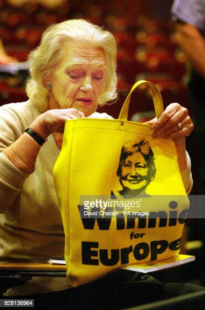 Scottish National Party supporter looks in an old bag promoting Winnie Ewing, former MP who is stepping down as Party President, at the party...