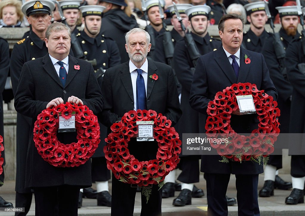 Scottish National Party's Parliamentary Group Leader Angus Robertson, Labour leader Jeremy Corbyn and British Prime Minister David Cameron attend the annual Remembrance Sunday Service at the Cenotaph, Whitehall on November 8, 2015 in London, England.