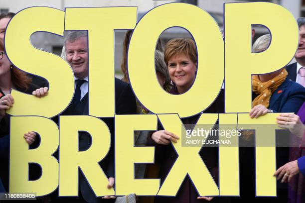 TOPSHOT Scottish Nationalist Party leader and Scotland's First Minister Nicola Sturgeon poses with party members and a 'Stop Brexit' sign to launch...