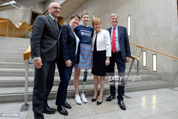 Scottish party leaders Patrick Harvie Ruth Davidson Nicola Sturgeon and Richard Leonard in the lobby of the Scottish Parliament with 17yearold...