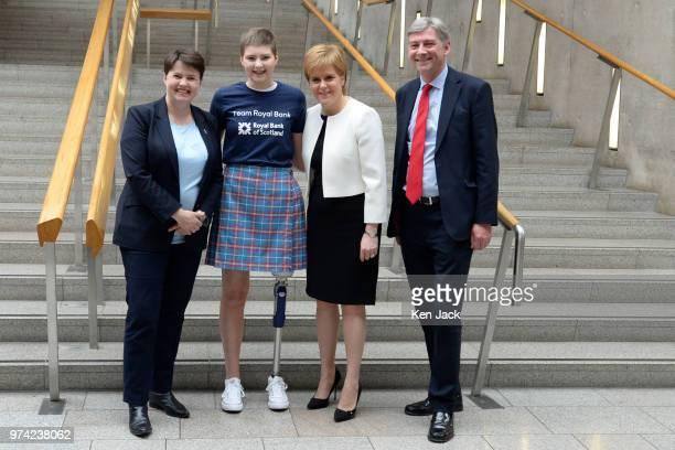Scottish party leaders Ruth Davidson Nicola Sturgeon and Richard Leonard in the lobby of the Scottish Parliament with 17yearold amputee Johanna Lambe...
