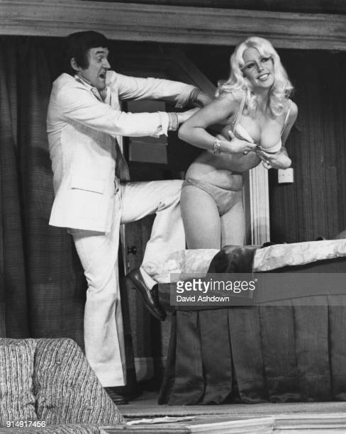 Scottish performer Jimmy Logan and actress Vivienne Johnson rehearse a farcical scene for the new Brian Rix play 'A Bit Between the Teeth' at the...