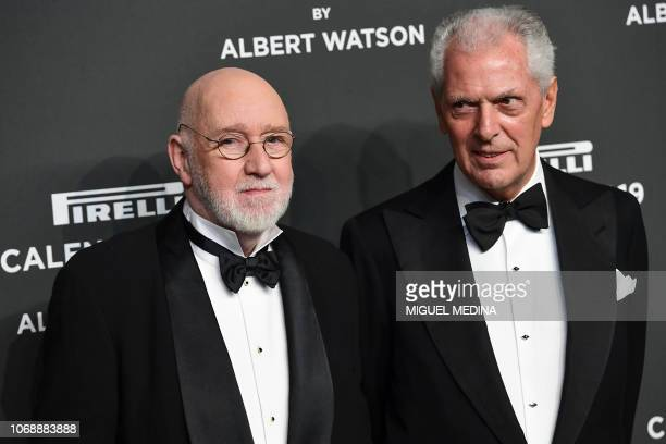 Scottish photographer Albert Watson and Pirelli's CEO Marco Tronchetti Provera pose on the red carpet upon their arrival at the 2019 Pirelli Calendar...