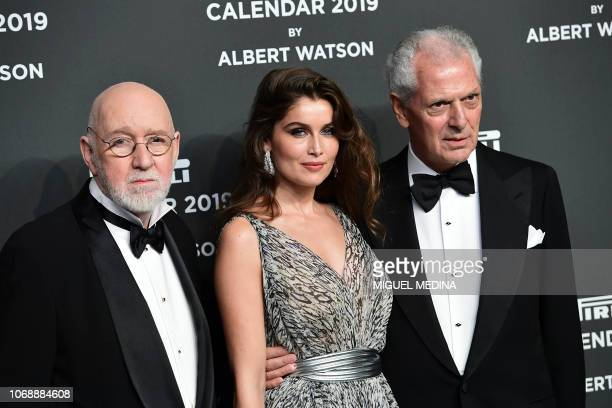 Scottish photographer Albert Watson , French actress and model Laetitia Casta and Pirelli's CEO Marco Tronchetti Provera pose on the red carpet upon...