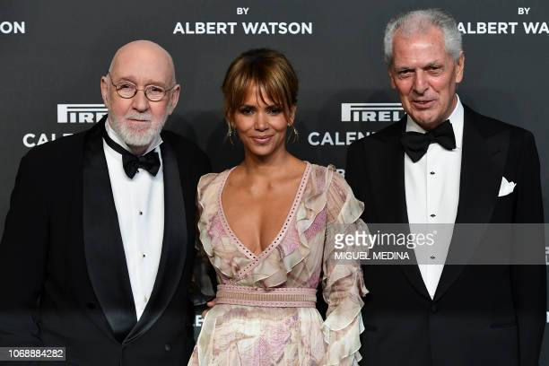 Scottish photographer Albert Watson , US actress Halle Berry and Pirelli's CEO Marco Tronchetti Provera pose on the red carpet upon their arrival at...