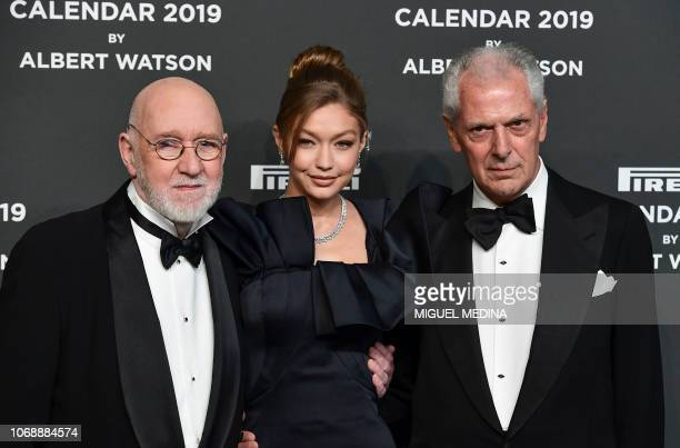 Scottish photographer Albert Watson , US model Gigi Hadid and Pirelli's CEO Marco Tronchetti Provera pose on the red carpet upon their arrival at the...