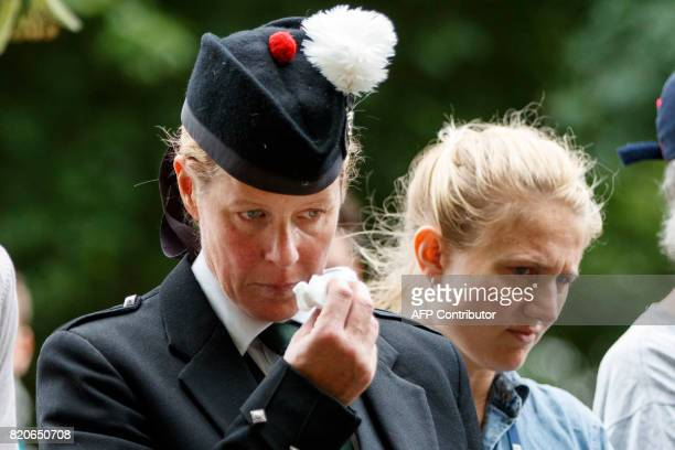 A Scottish piper sheds a tear at the memorial to those who died in a 1982 IRA bomb attack after a march to demand justice in London on July 22 2017...