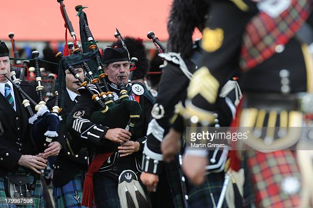 Scottish pipers play the bagpipes at the annual Braemer Highland Games at The Princess Royal and Duke of Fife Memorial Park on September 7 2013 in...