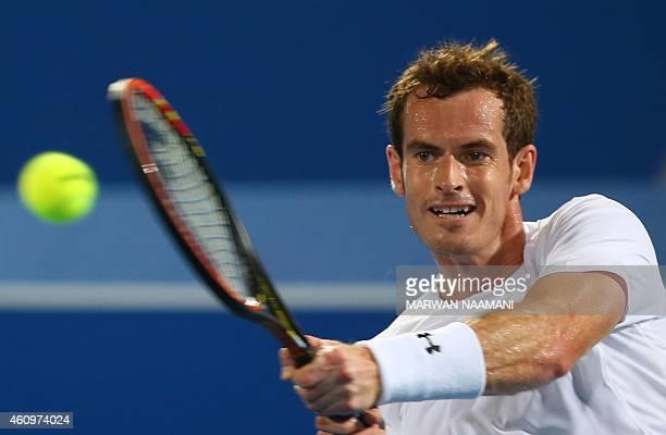 Scottish player Andy Murray returns the ball to Spanish tennis player Rafael Nadal during their semifinal tennis match in the Mubadala World Tennis...