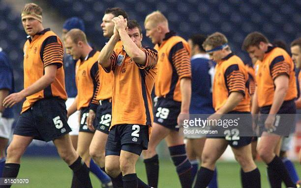 Scottish players leave the ground at the end of the Rugby World Cup quarterfinal playoff match between Scotland and Samoa at the Murrayfield stadium...