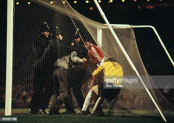Scottish police move in to remove a hooligan attacking Rapid Vienna goalkeeper Herbert Feurer during their European Cup Winners Cup 2nd round 2nd leg...