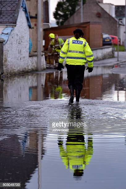 scottish police officer at the scene of flooding - johnfscott stock pictures, royalty-free photos & images