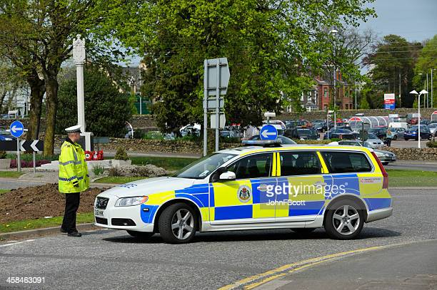 scottish police officers and a parked police car - police car stock photos and pictures
