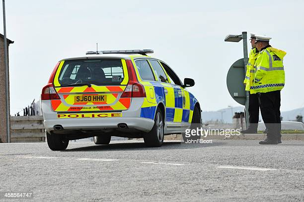 Scottish police officers and a parked police car