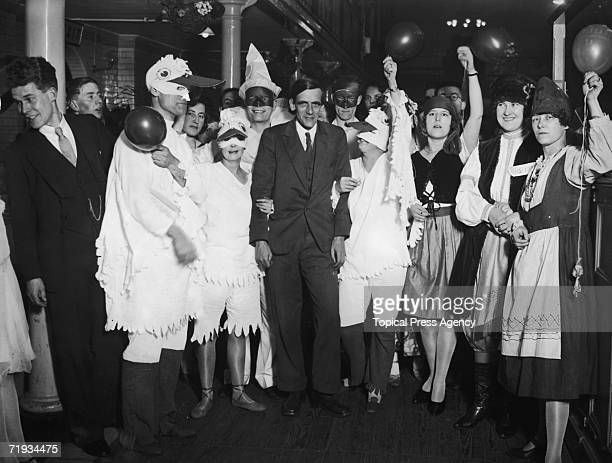 Scottish politician James Maxton leader of the Independent Labour Party stands out from the other revellers during the ILP ball at Lambeth Baths 7th...