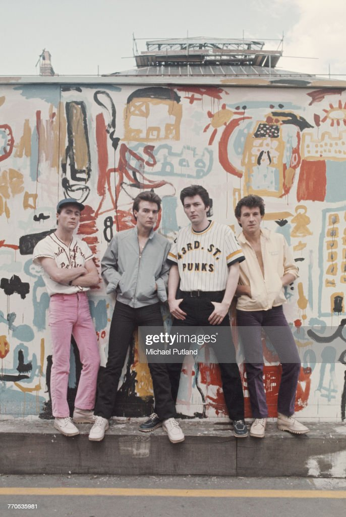 Scottish pop group Slik posed together wearing baseball tops, blouson jackets and Kickers boots in front of a painted backdrop in London, 20th May 1976. Left to right: keyboard player Billy McIsaac, guitarist Midge Ure, bassist Jim McGinlay and drummer Kenny Hyslop.