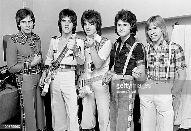 Scottish pop group The Bay City Rollers Alan Longmuir Stuart 'Woody' Wood Eric Faulkner Les McKeown and Derek Longmuir pose for a group portrait...