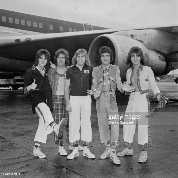 Scottish pop rock band Bay City Rollers at Heathrow Airport London UK 1st October 1975 they are Stuart John Wood Alan Longmuir Derek Longmuir Les...