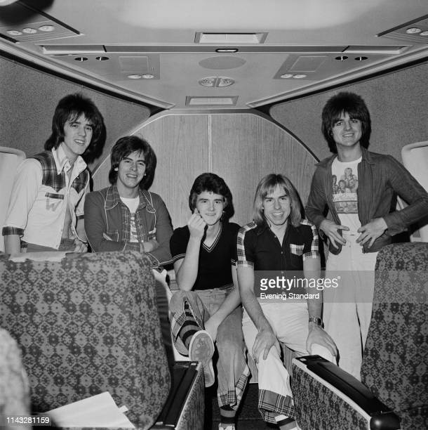 Scottish pop rock band Bay City Rollers on a plane leaving for an Australian tour UK 28th November 1975 they are Stuart John Wood Alan Longmuir Les...