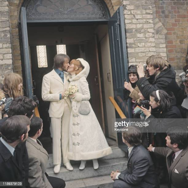 Scottish pop singer Lulu and English musician Maurice Gibb of the Bee Gees after their wedding at Gerrards Cross Church in Buckinghamshire, 18th...