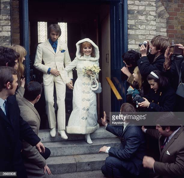 Scottish pop singer Lulu emerges from Gerrards Cross Church Buckinghamshire with her new husband Maurice Gibb of the Bee Gees