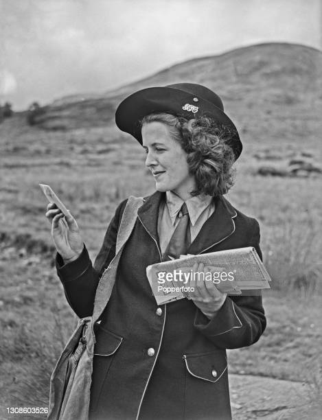 Scottish postwoman Jean Cameron checks the address on a letter during her postal delivery round in the Glen Clova valley near Dundee, Scotland during...
