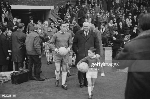 Scottish professional footballer and captain of Birmingham City, Ron Wylie leads out the team with former Birmingham City centre forward Joe Bradford...