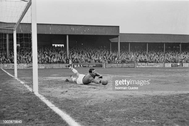 Scottish professional footballer and goalkeeper with Peterborough United FC, Willie Duff pictured making a save during a match between Walsall FC and...
