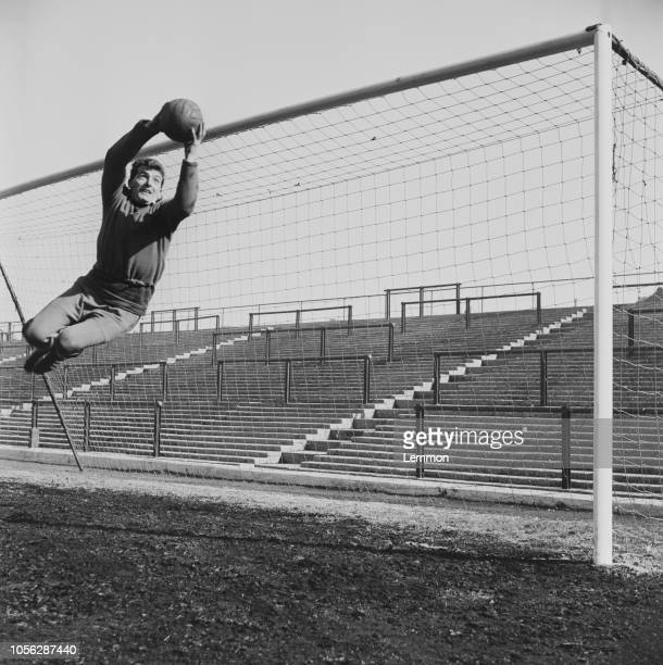 Scottish professional footballer and goalkeeper with Portsmouth FC, John Armstrong pictured saving a ball during training at the club's Fratton Park...