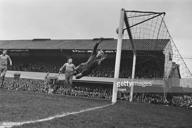 Scottish professional footballer and goalkeeper with Wolverhampton Wanderers Dave MacLaren dives in vain as Coventry score the winning goal in the...