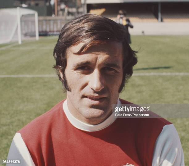 Scottish professional footballer and midfielder with Arsenal Football Club George Graham posed on the pitch at Highbury stadium in north London...