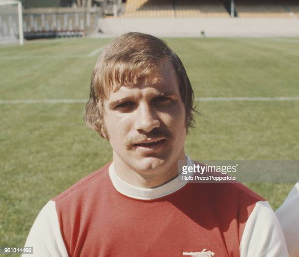 Scottish professional footballer and midfielder with Arsenal Football Club Eddie Kelly posed on the pitch at Highbury stadium in north London during...