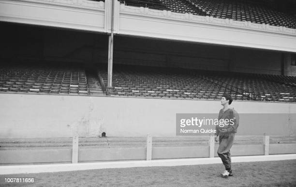 Scottish professional footballer and midfielder with Rangers FC Jim Baxter at the side of the pitch during a training session at Arsenal's Highbury...