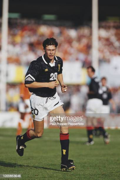 Scottish professional footballer Duncan Ferguson forward with Dundee United FC pictured in action playing for the Scotland national team in their...