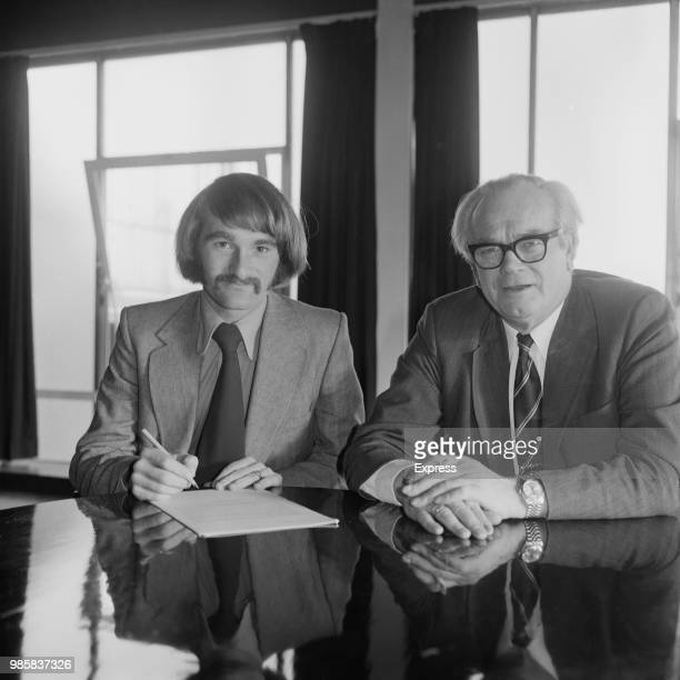 Scottish professional footballer Iain Phillip pictured signing an agreement with Crystal Palace chairman Arthur Wait as he transfers to Crystal...