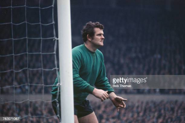 Scottish professional footballer Tommy Lawrence pictured playing as goalkeeper for Liverpool FC during a match against Manchester United at Old...