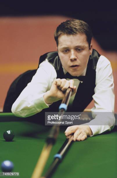 Scottish professional snooker player John Higgins pictured in action during competition in the 1996 Embassy World Snooker Championship at the...