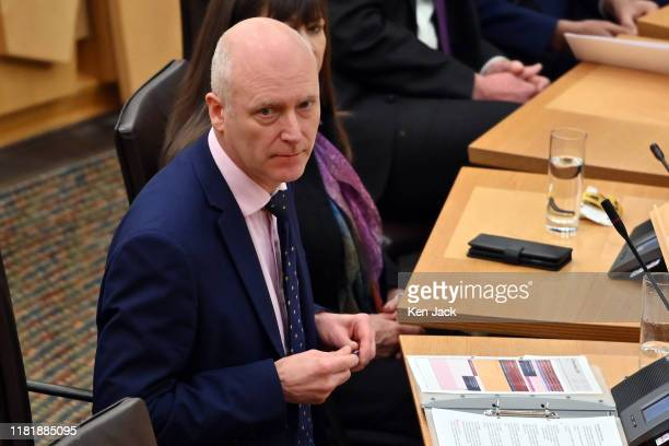 Scottish Public Health Minister Joe FitzPatrick listens during Topical Questions in the Scottish Parliament where the issue of two cases of...