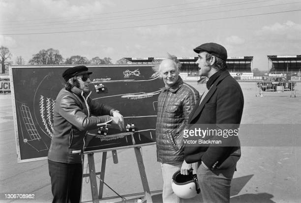 Scottish racing driver Jackie Stewart giving advanced driving tuition to Lord Montagu of Beaulieu and Scottish actor Sean Connery at Silverstone,...