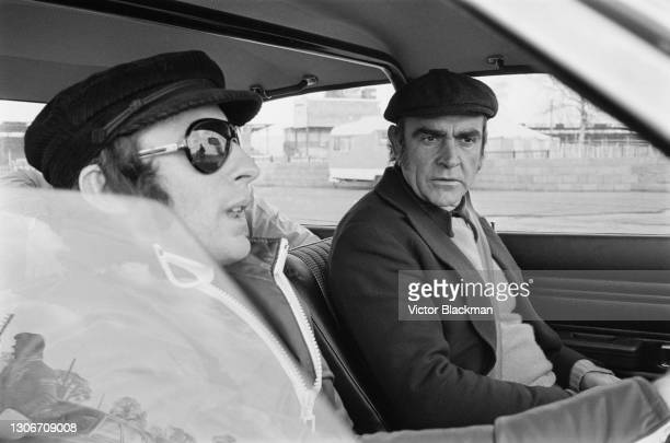 Scottish racing driver Jackie Stewart giving advanced driving tuition to Scottish actor Sean Connery at Silverstone, Northamptonshire, 9th April 1973.