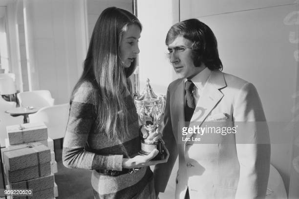 Scottish racing driver Jackie Stewart pictured with Nina Rindt widow of Austrian racing driver Jochen Rindt in London on 18th November 1970 Nina...