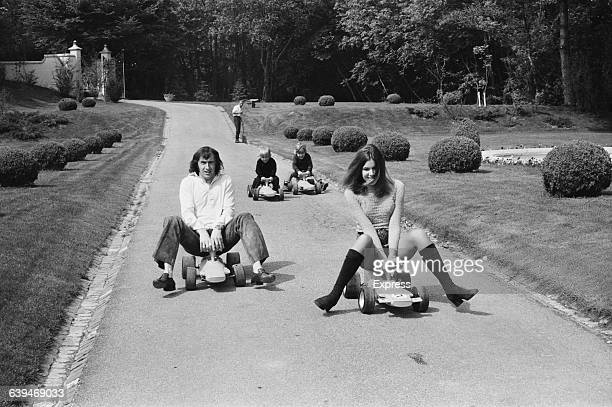 Scottish racing driver Jackie Stewart with his wife Helen and their sons Paul and Mark on gokarts 18th May 1971