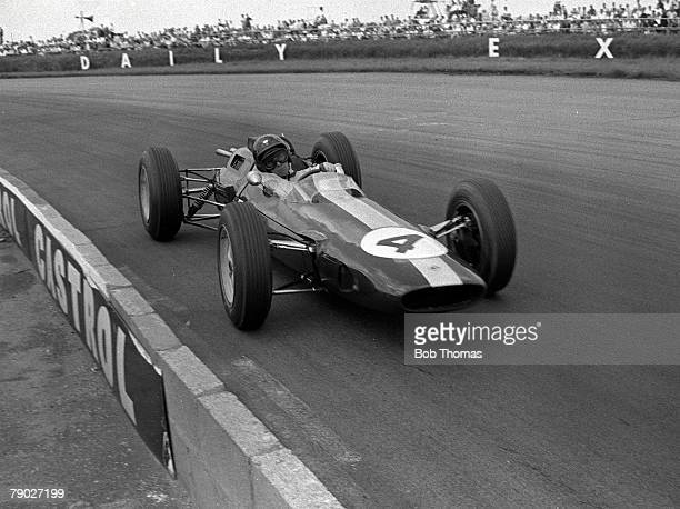 Scottish racing driver Jim Clark drives the Team Lotus Lotus 25 Climax V8 to finish in first place to win the 1963 British Grand Prix at Silverstone...